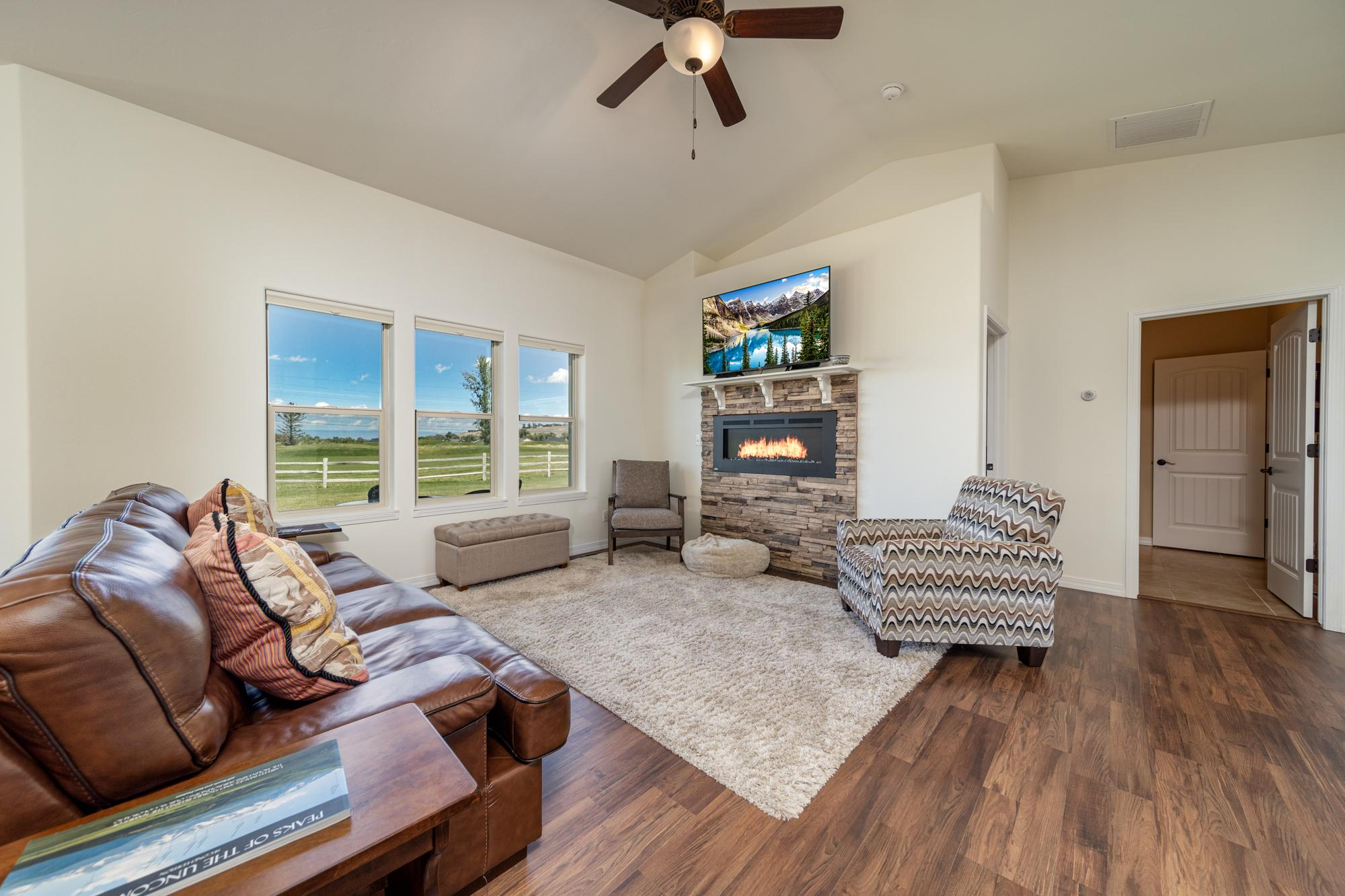 Living Room with Natural Lighting - 597 Cobble Dr Montrose, CO - Atha Team MLS Colorado