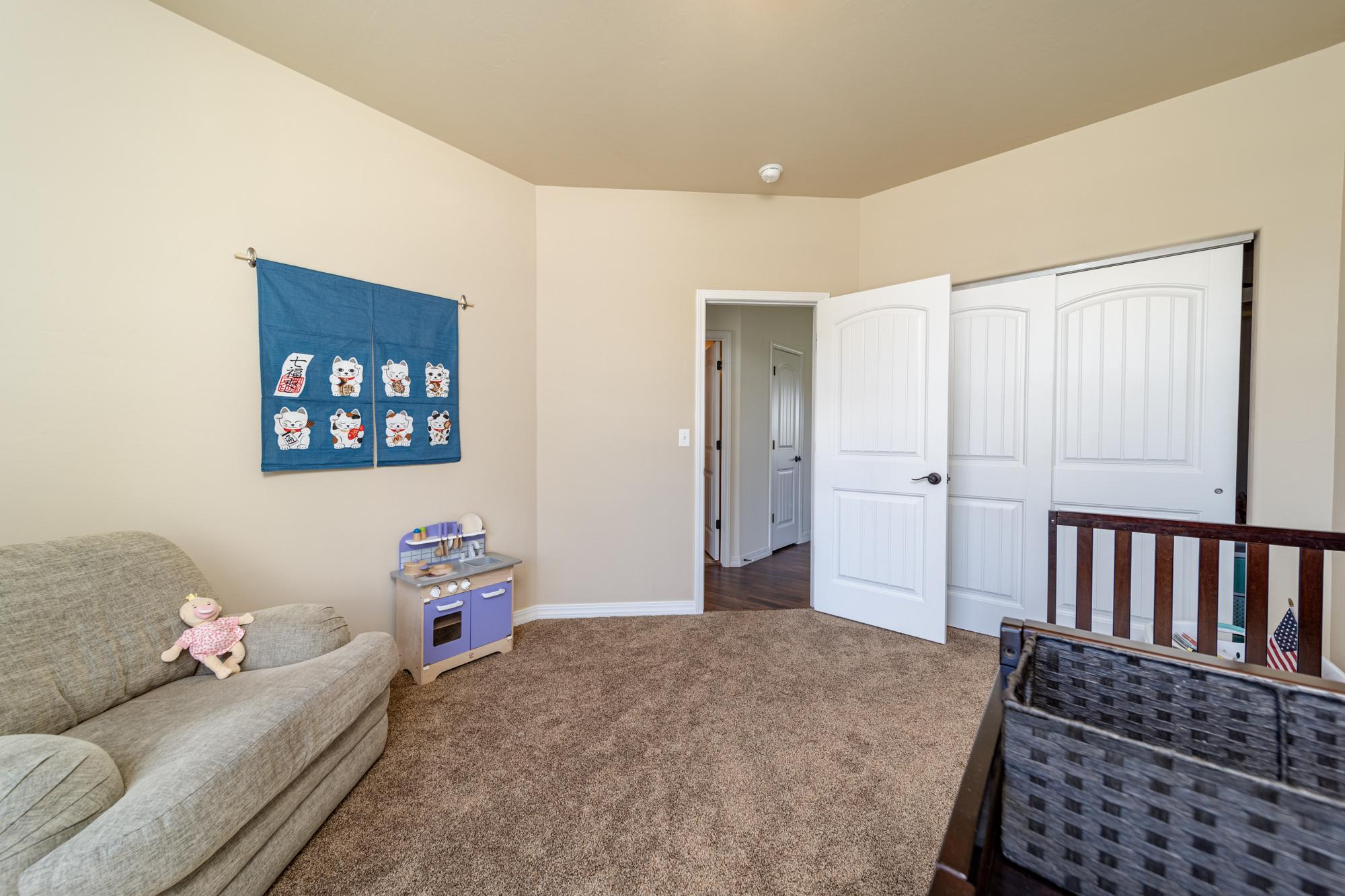 2nd Bedroom with Closet - 597 Cobble Dr Montrose, CO - Atha Team MLS Colorado