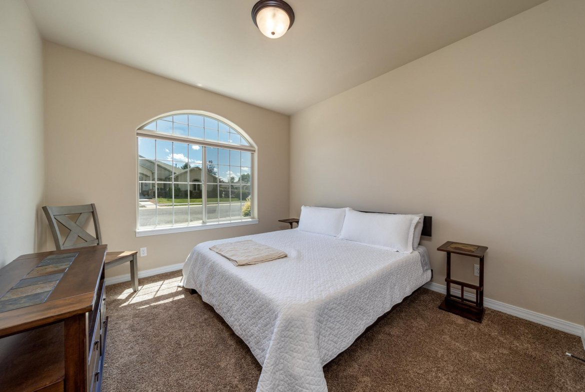 Guest Bedroom with Carpet - 597 Cobble Dr Montrose, CO - Atha Team MLS Colorado