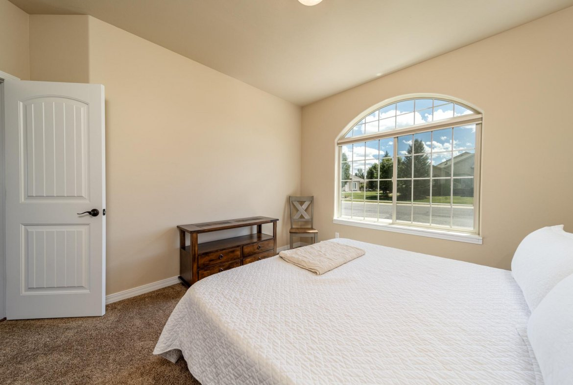 Guest Bedroom with Large Window - 597 Cobble Dr Montrose, CO - Atha Team MLS Colorado