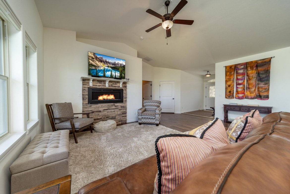Living Room with Fireplace - 597 Cobble Dr Montrose, CO - Atha Team MLS Colorado