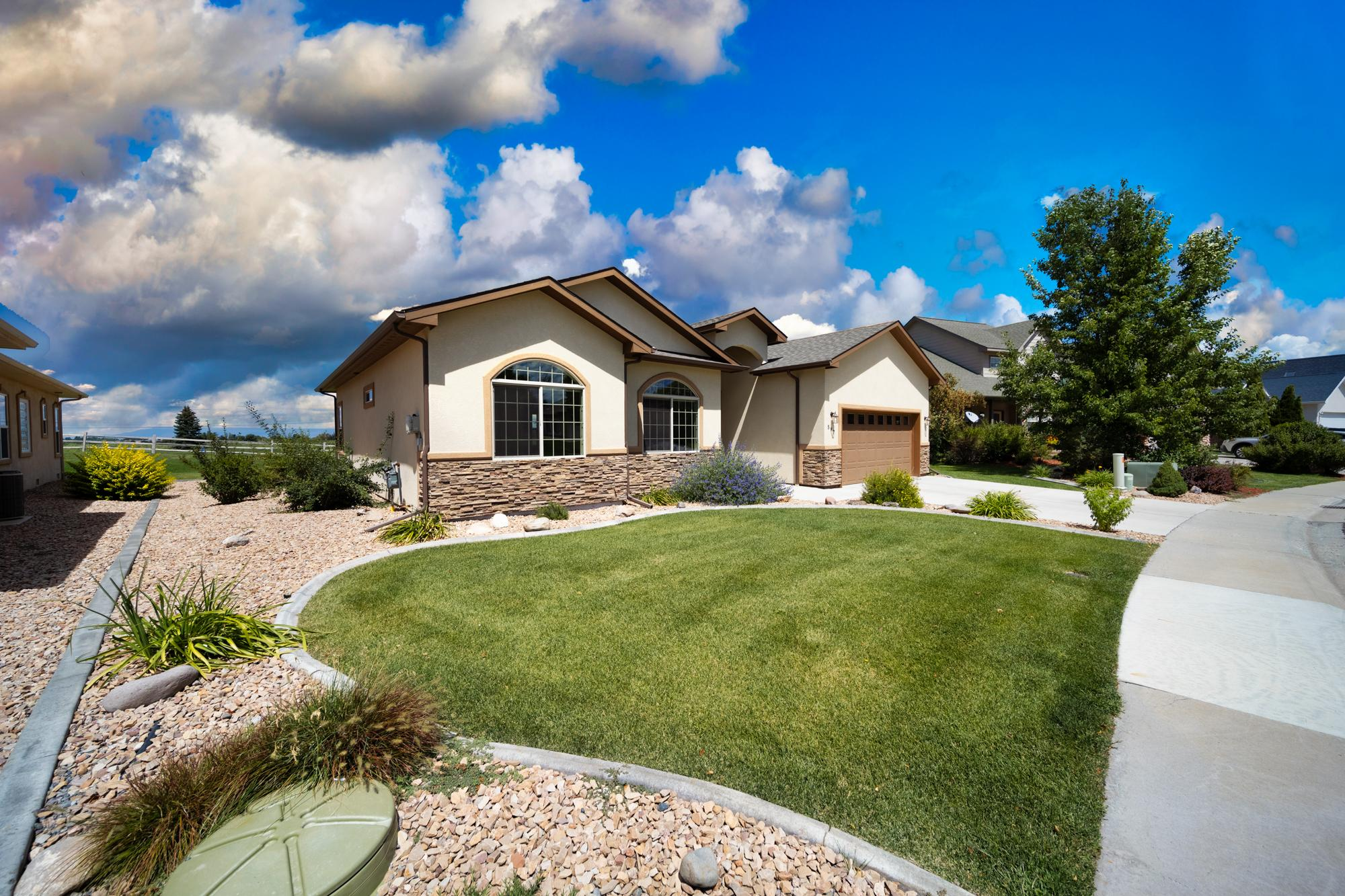 Landscaping with Irrigation System - 597 Cobble Dr Montrose, CO - Atha Team MLS Colorado