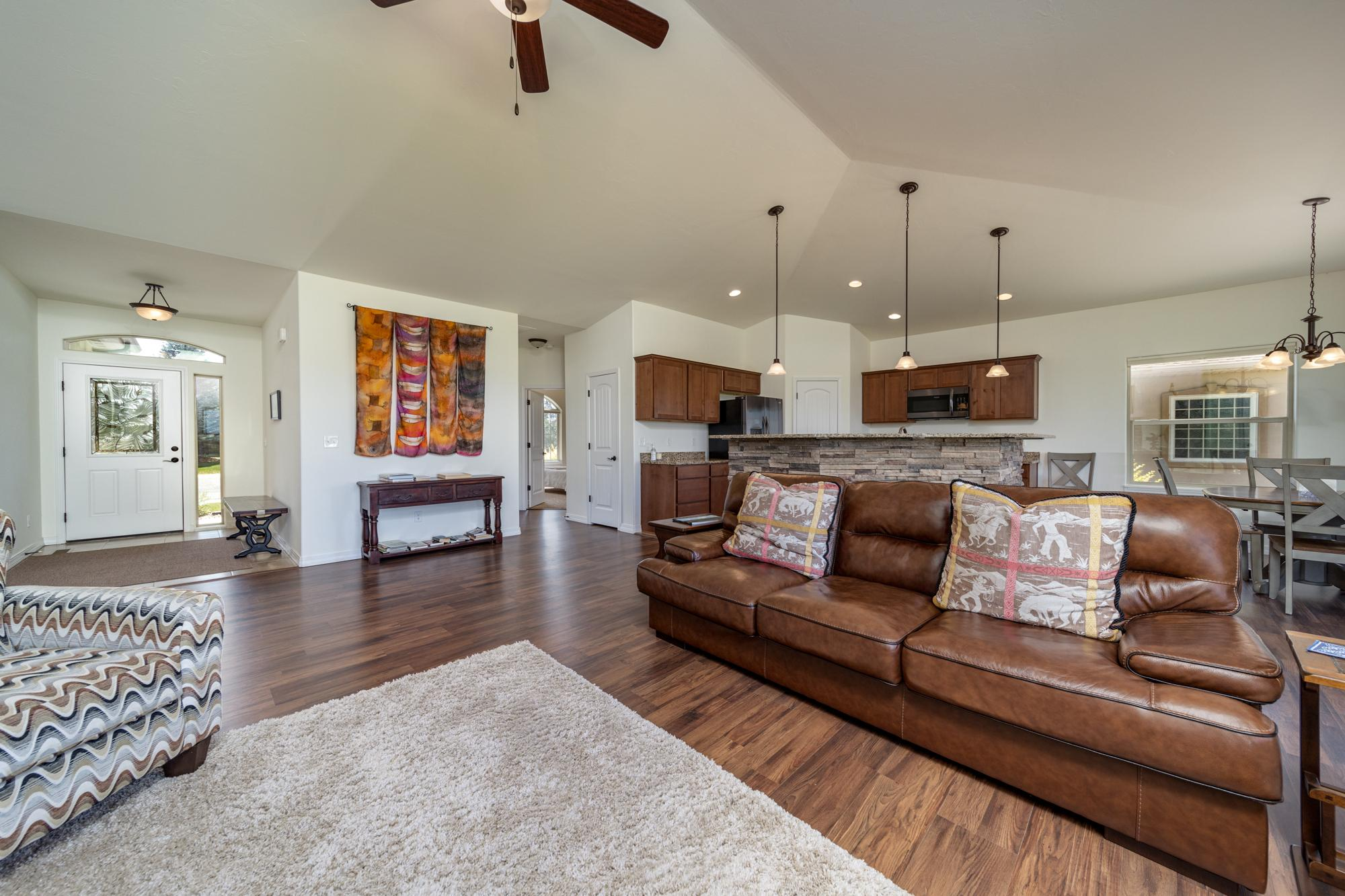 Living Room with Vaulted Ceiling - 597 Cobble Dr Montrose, CO - Atha Team MLS Colorado