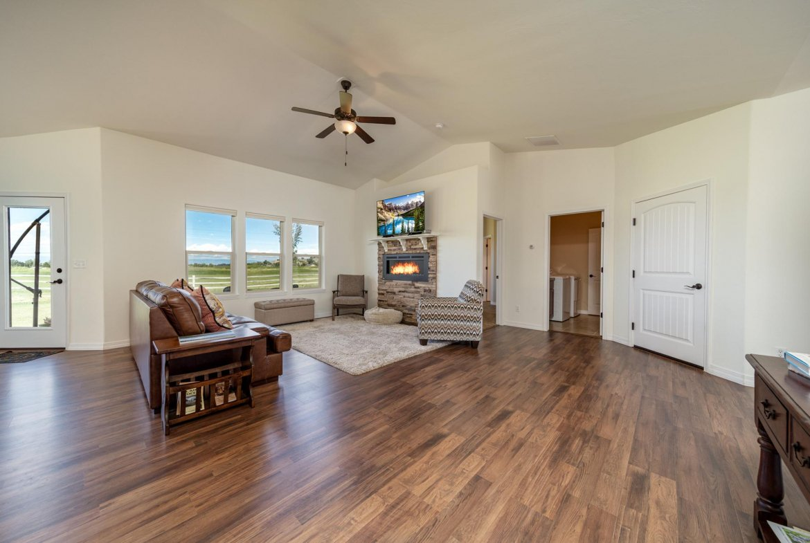 Living Room with Bay Windows - 597 Cobble Dr Montrose, CO - Atha Team MLS Colorado