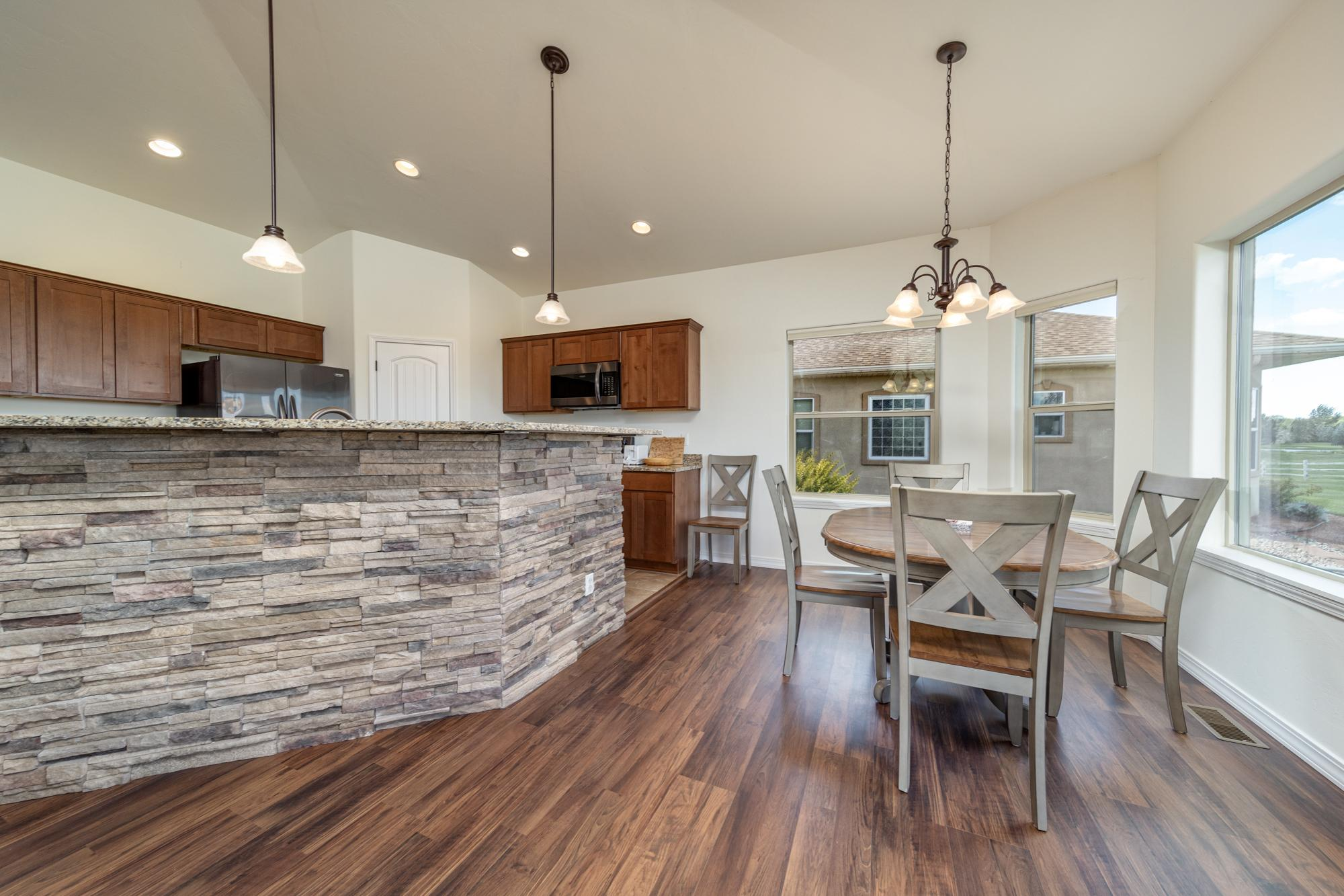 Kitchen and Dining Area - 597 Cobble Dr Montrose, CO - Atha Team MLS Colorado