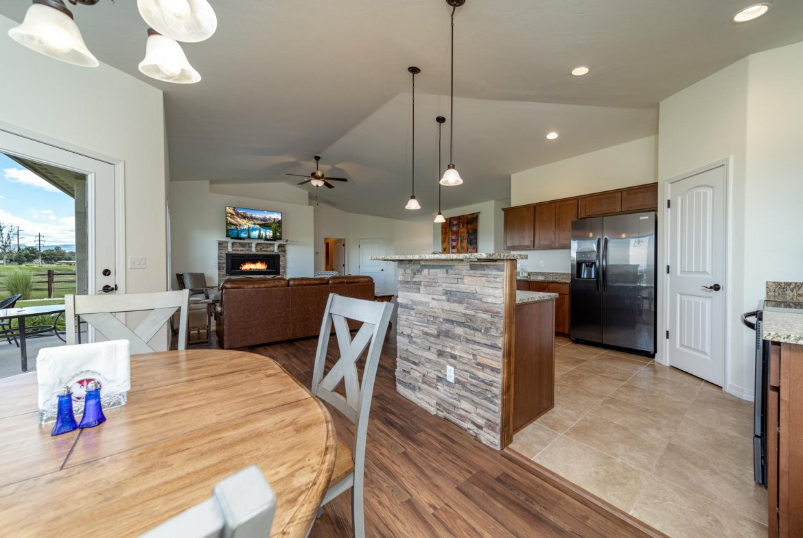 Dining Area with Laminate Flooring - 597 Cobble Dr Montrose, CO - Atha Team MLS Colorado