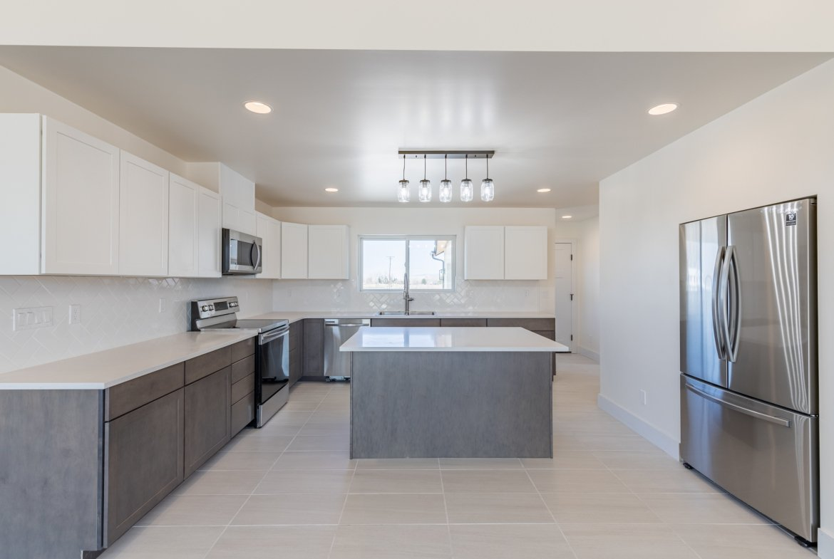 Kitchen with Center Island - 21591 Hwy 550 Montrose, CO - Atha Team Realty