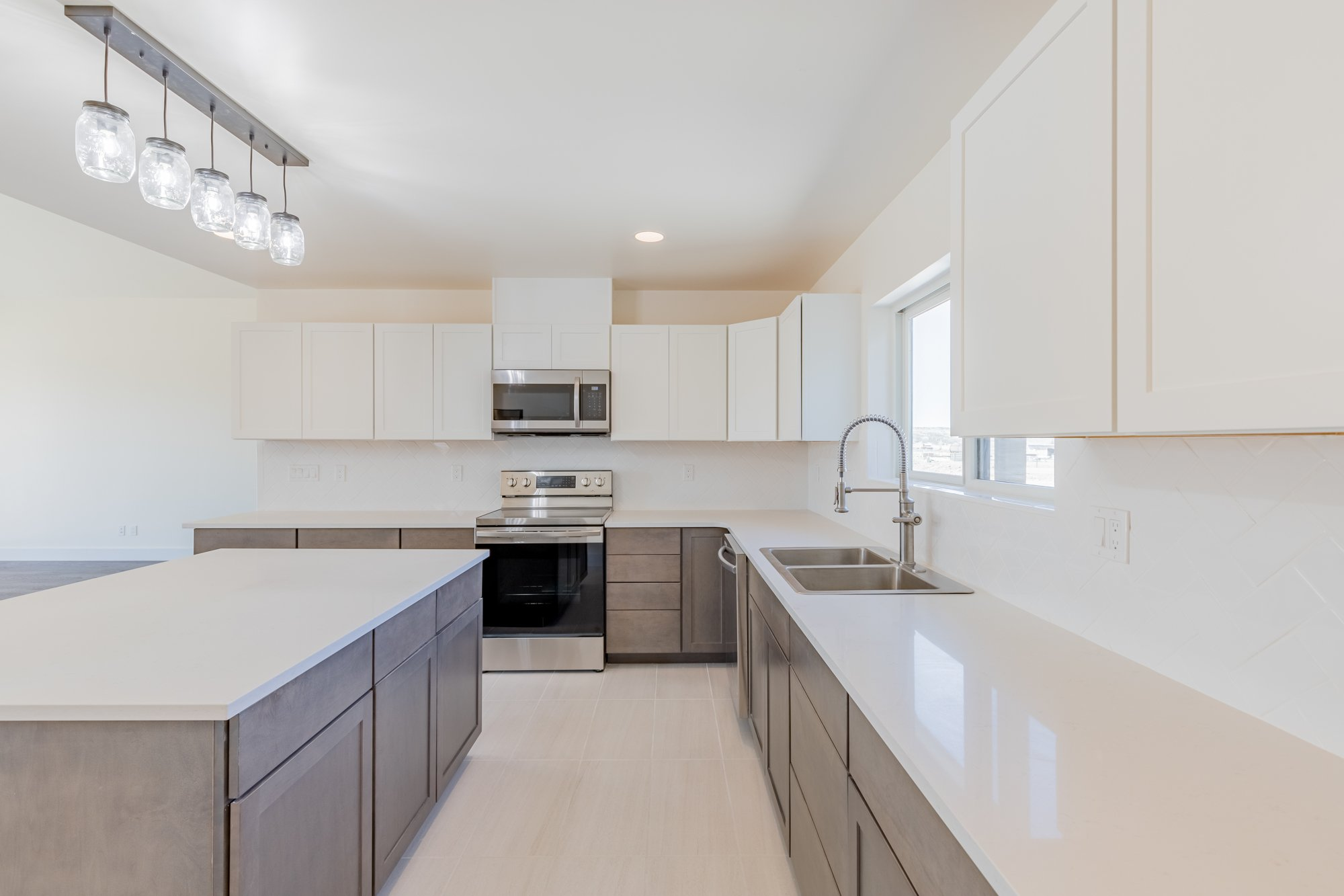 Kitchen with Quartz Countertops - 21591 Hwy 550 Montrose, CO - Atha Team Realty
