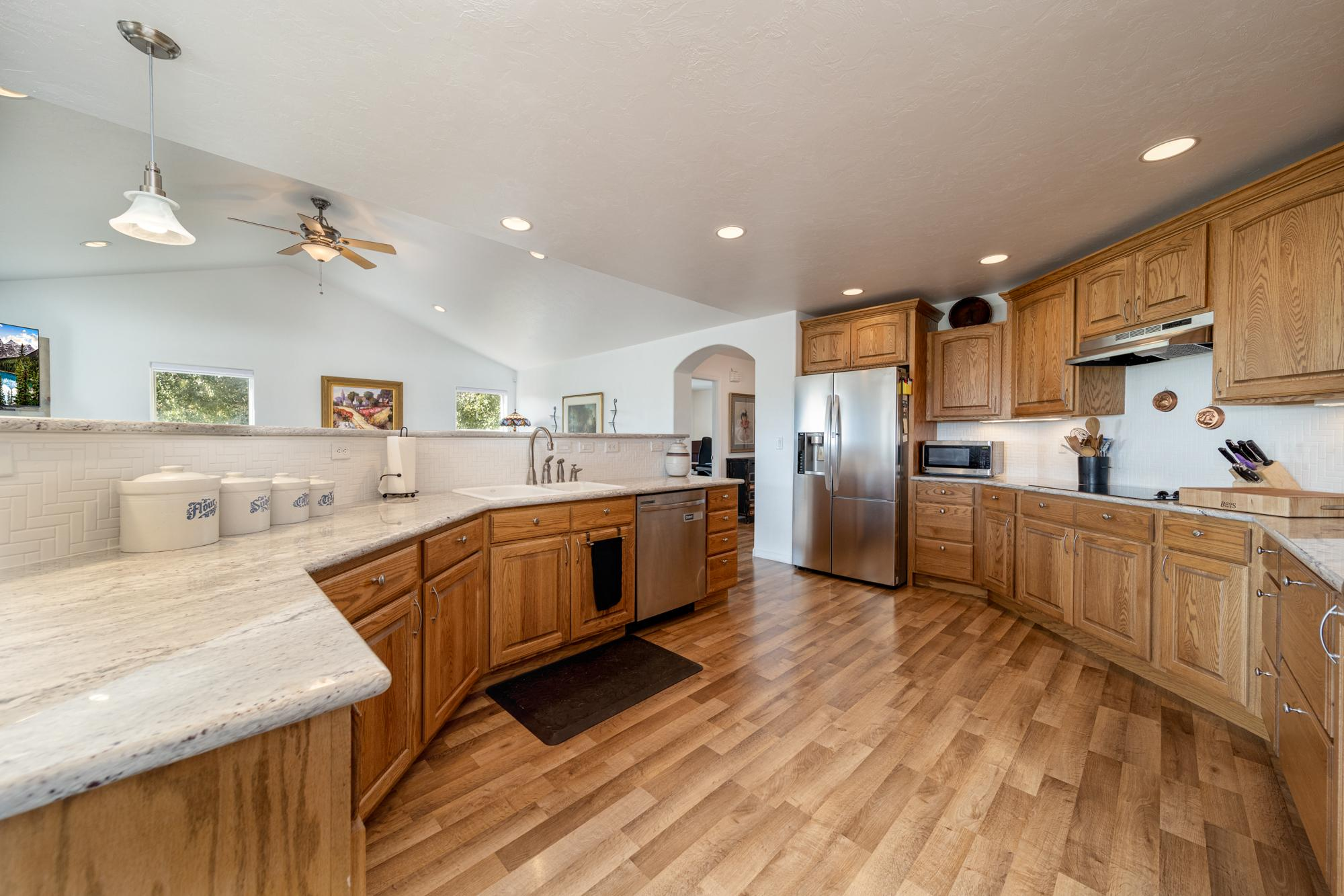 Kitchen with Laminate Flooring - 15552 6120 Rd Montrose, CO 81403 - Atha Team Country Real Estate