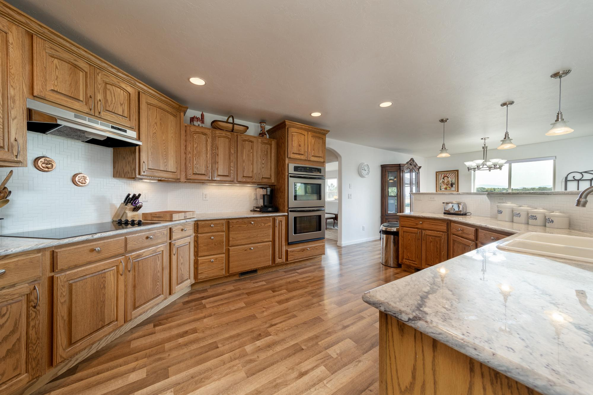 Kitchen with Granite Counters - 15552 6120 Rd Montrose, CO 81403 - Atha Team Country Real Estate