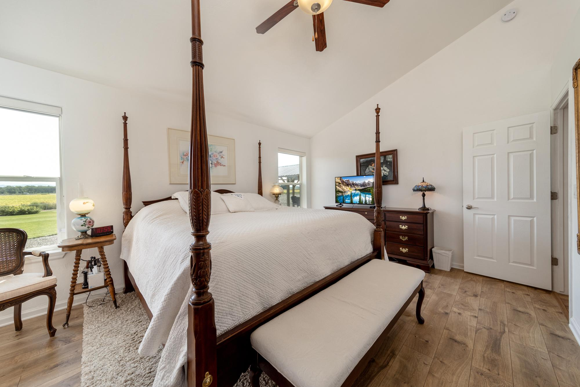 Primary Bedroom with Walkout Patio - 15552 6120 Rd Montrose, CO 81403 - Atha Team Country Real Estate