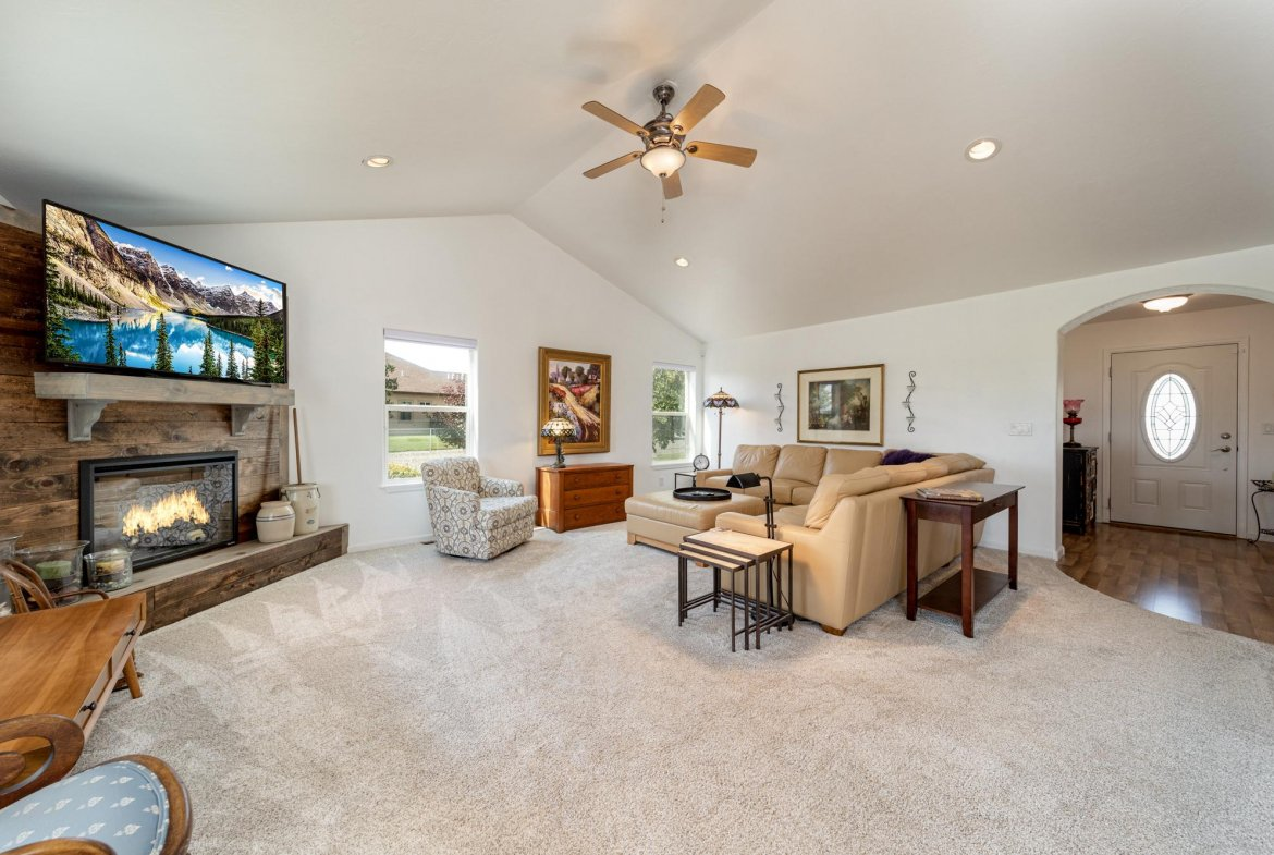 Living Room with Gas Log Fireplace - 15552 6120 Rd Montrose, CO 81403 - Atha Team Country Real Estate