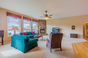 Living Room with Fireplace - 2941 Ivy Dr Montrose, CO 81401 - Atha Team Real Estate