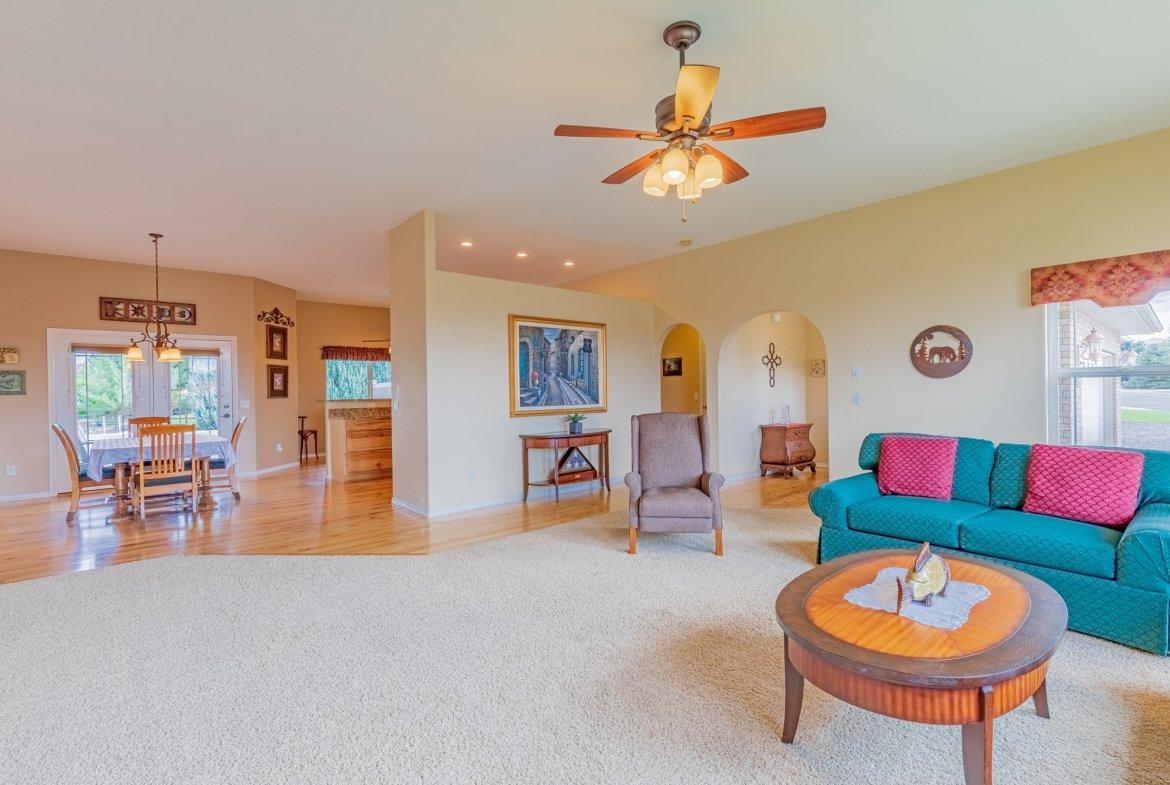 Living Room with Ceiling Fan - 2941 Ivy Dr Montrose, CO 81401 - Atha Team Real Estate
