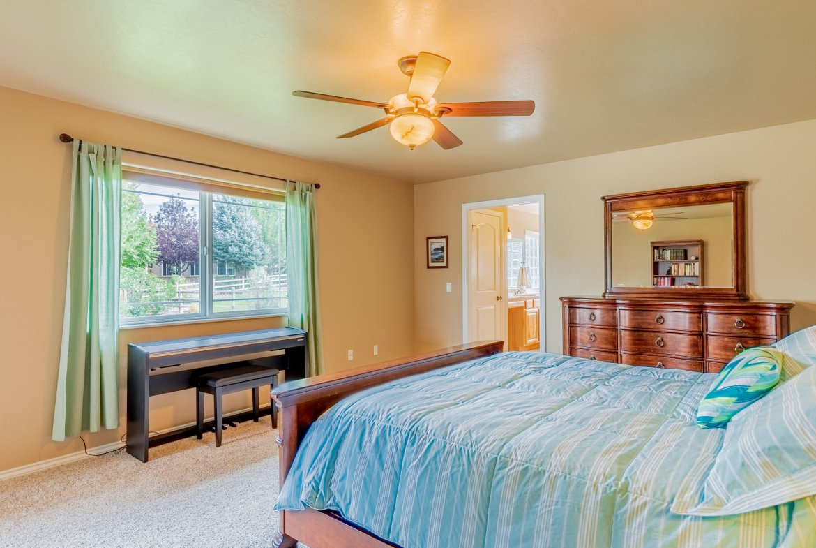 Primary Bedroom with Window - 2941 Ivy Dr Montrose, CO 81401 - Atha Team Real Estate