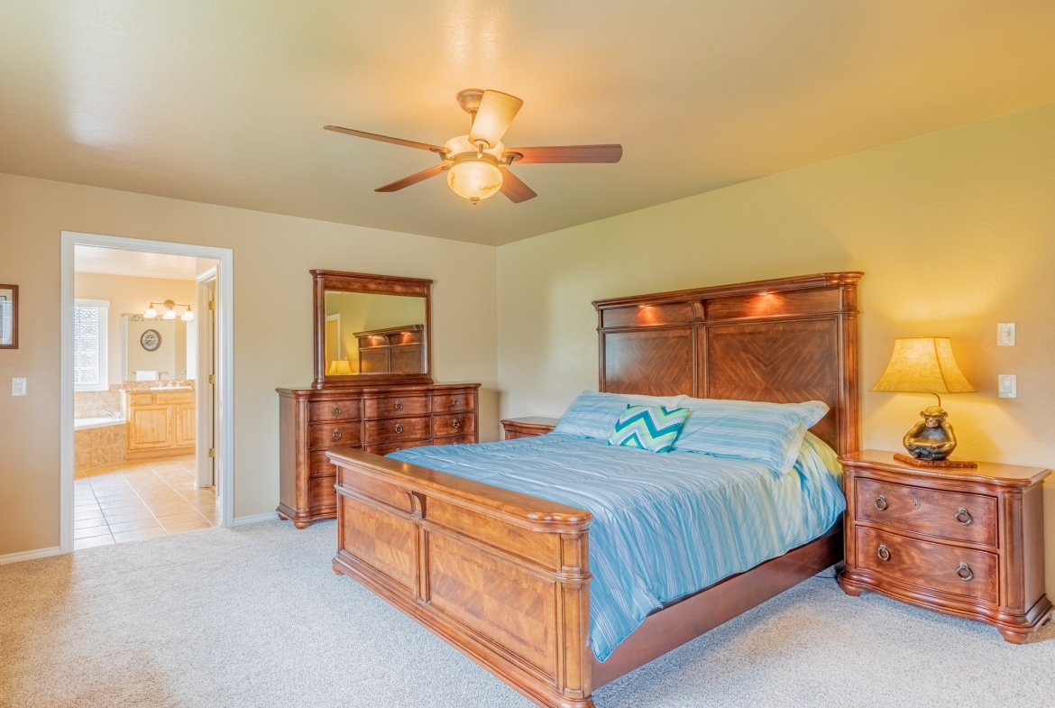 Main Bedroom with Ceiling Fan - 2941 Ivy Dr Montrose, CO 81401 - Atha Team Real Estate