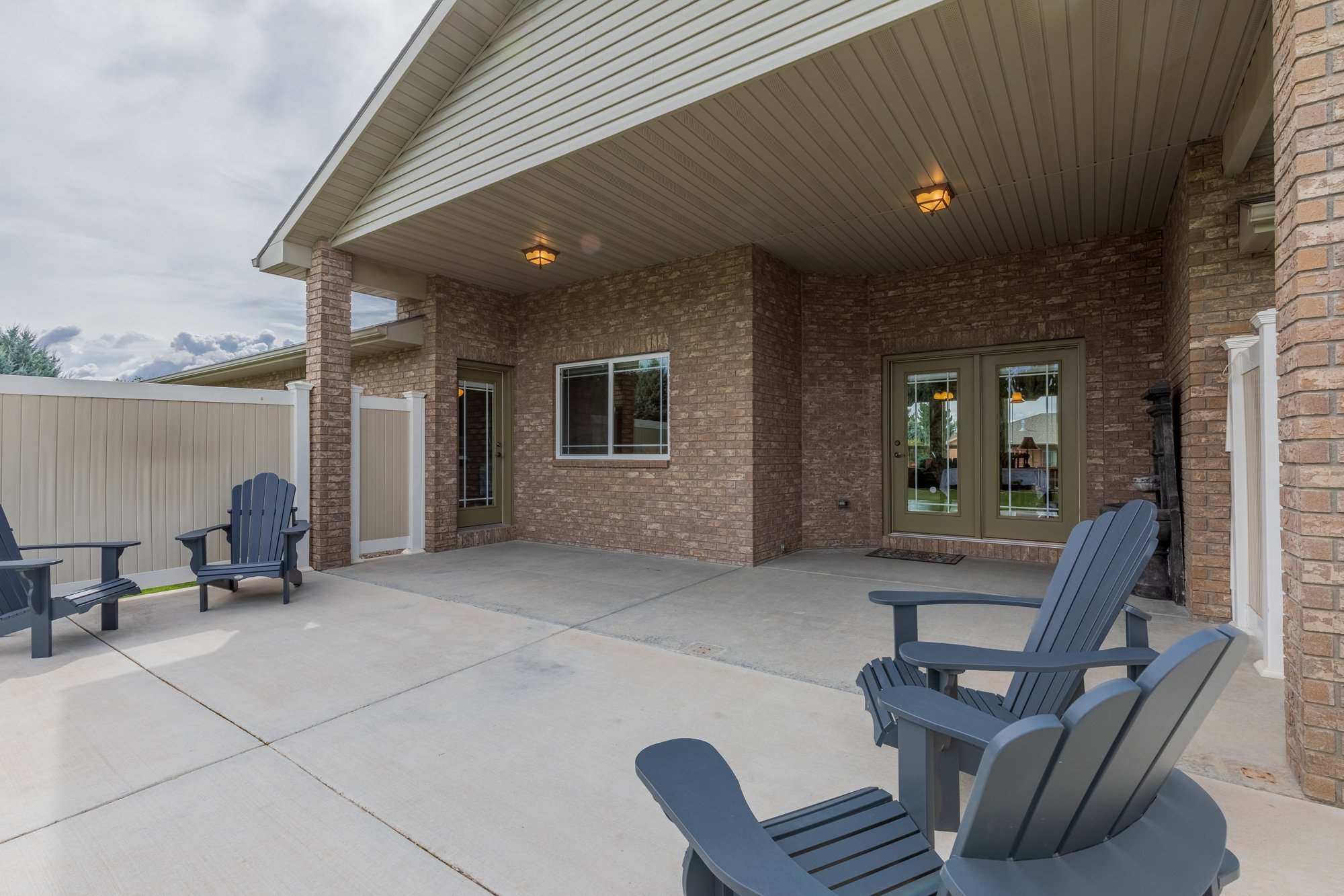 Covered Patio with Privacy Screening - 2941 Ivy Dr Montrose, CO 81401 - Atha Team Real Estate
