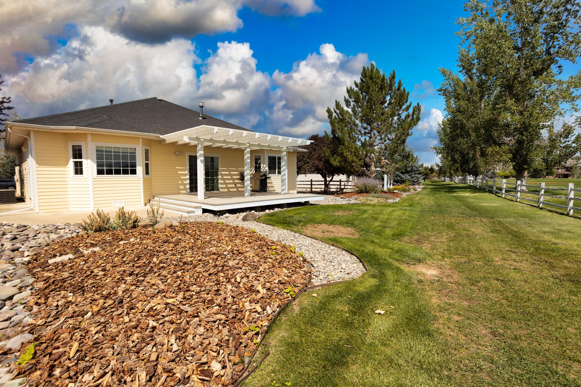 Back of Home and Patio - 3731 Buffalo Ln Montrose, CO 81403 - Atha Team Golf Property