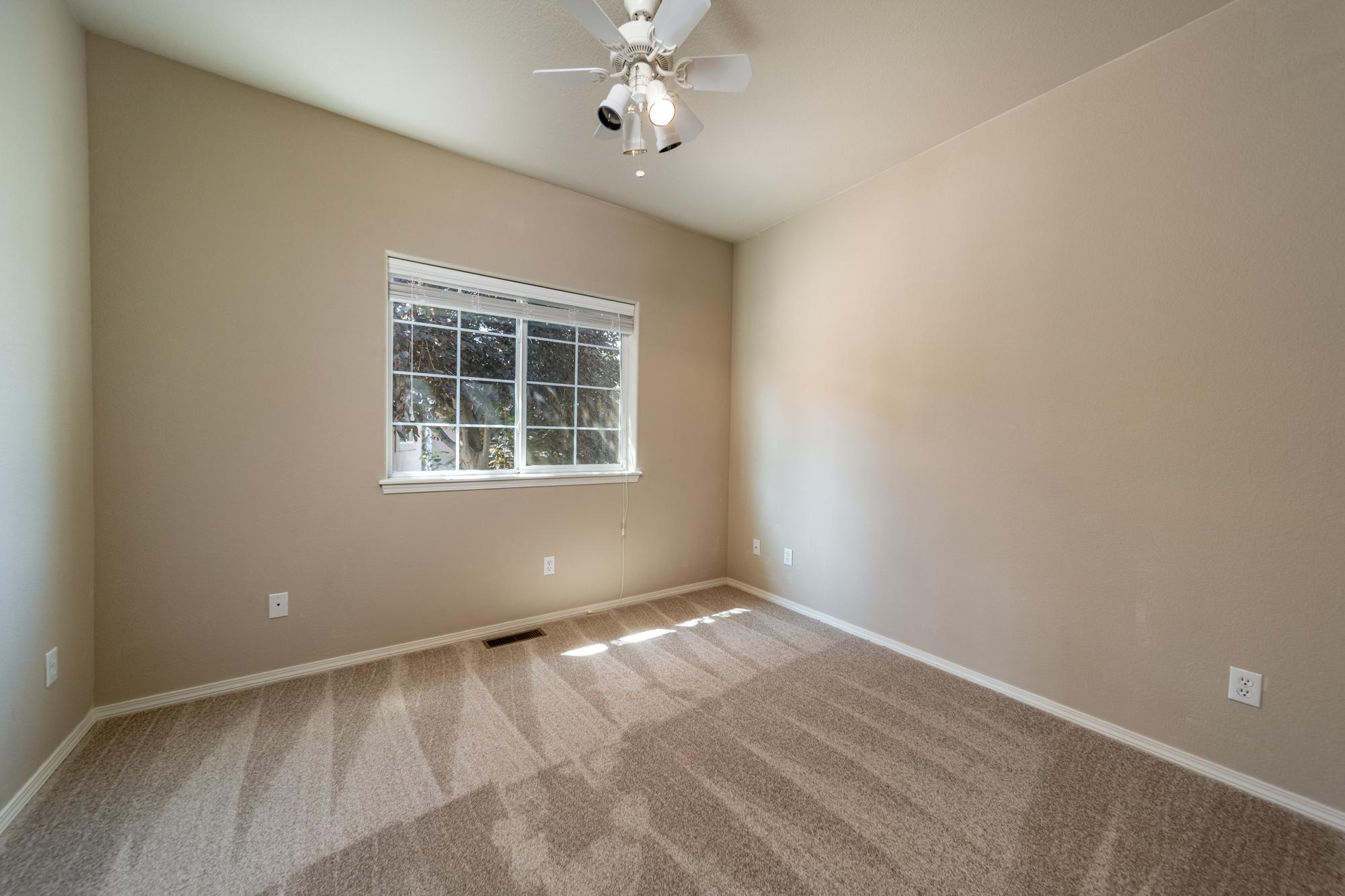 3rd Bedroom with Ceiling Fan - 3731 Buffalo Ln Montrose, CO 81403 - Atha Team Golf Property