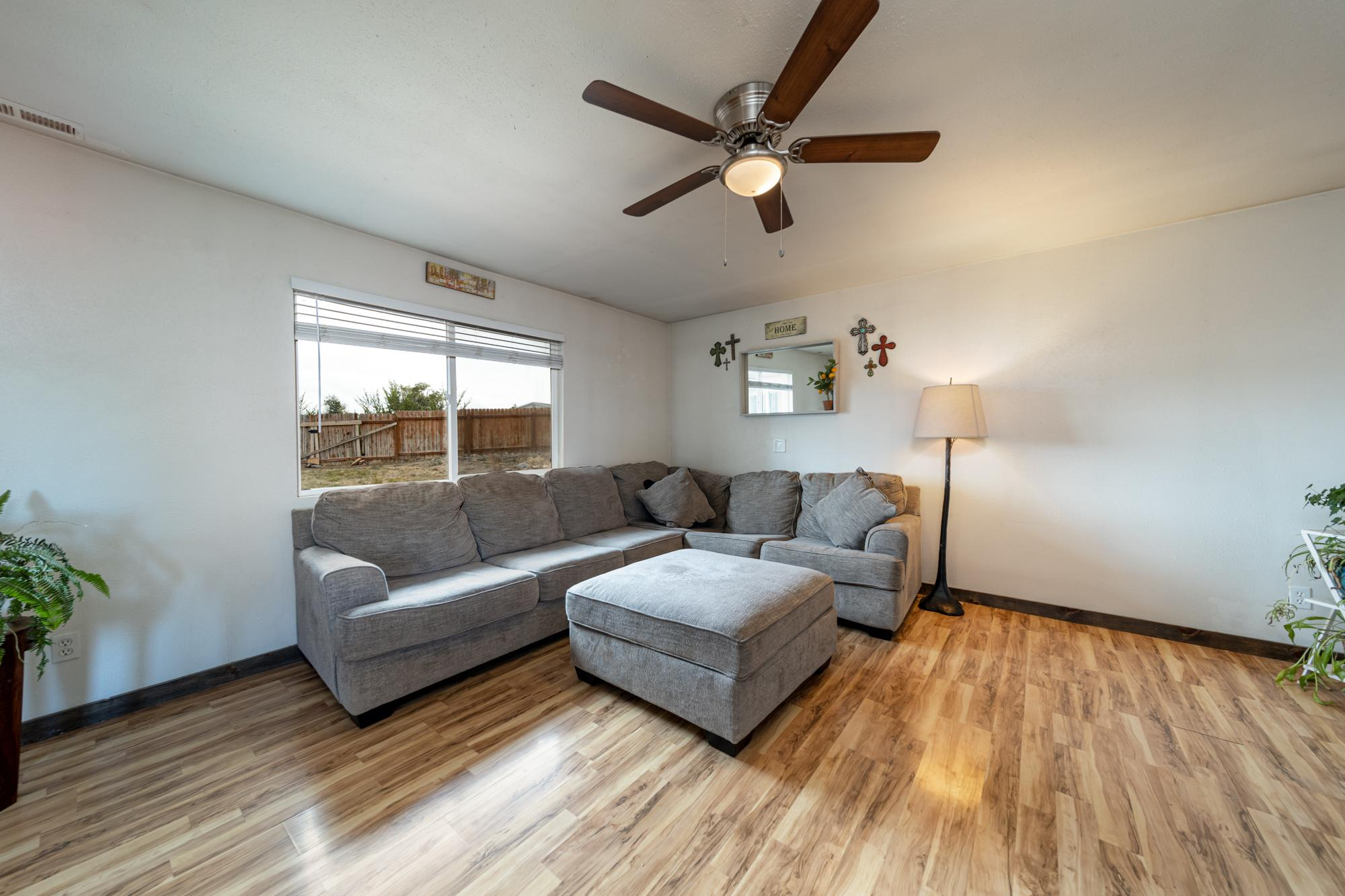 Living Room with Ceiling Fan - 1117 Centennial Dr Montrose, CO 81401 - Atha Team Real Estate