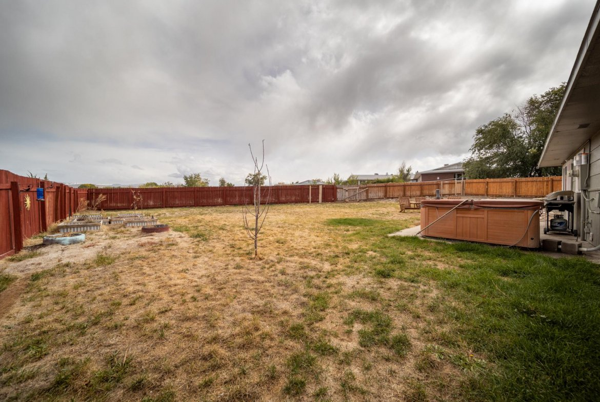 Back yard with Hot Tub - 1117 Centennial Dr Montrose, CO 81401 - Atha Team Real Estate