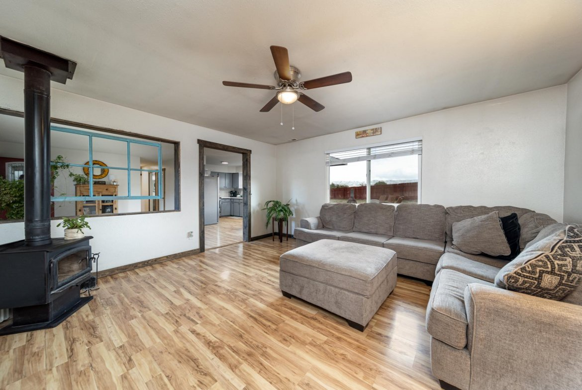 Living Room with Laminate Wood Flooring - 1117 Centennial Dr Montrose, CO 81401 - Atha Team Real Estate