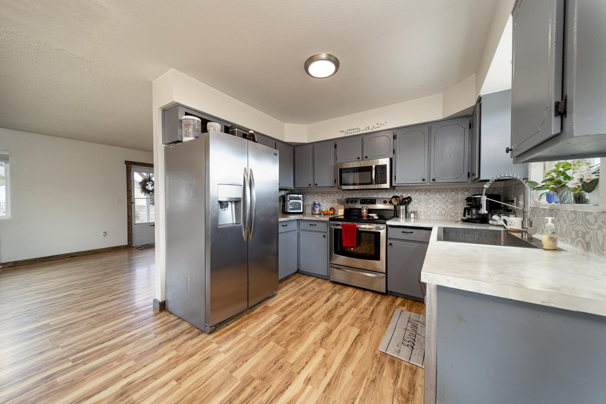 Kitchen with Stainless Appliances - 1117 Centennial Dr Montrose, CO 81401 - Atha Team Real Estate