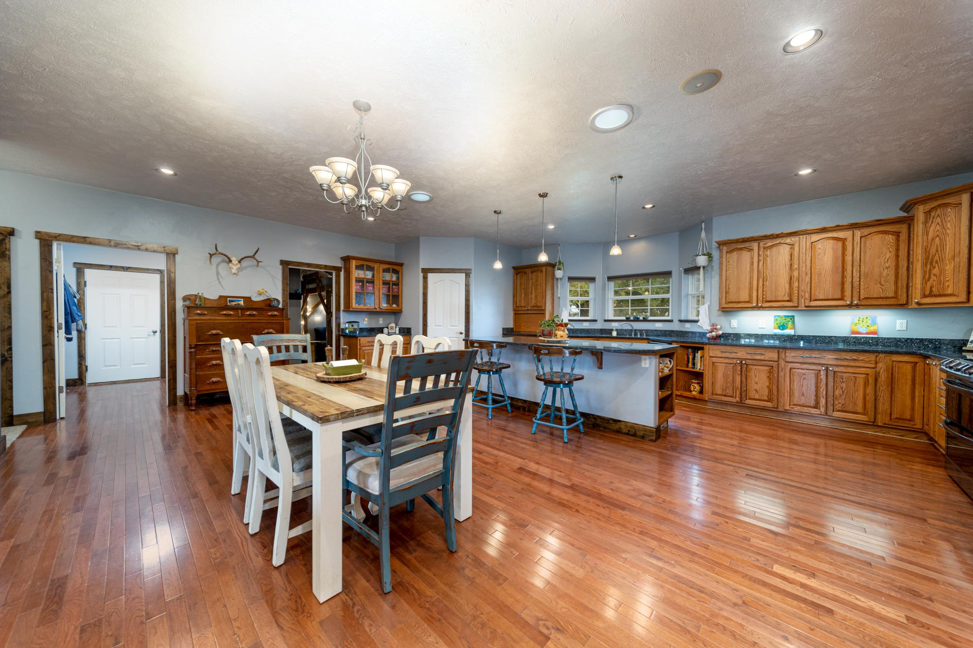 Large Dining and Kitchen Area - 12703 6100 Rd Montrose, CO 81403 - Atha Team Country Real Estate