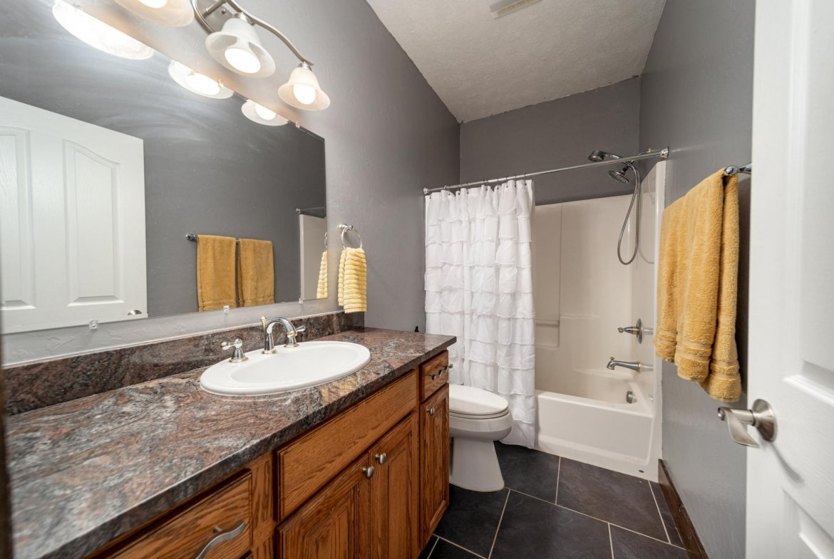 Full Bathroom with Tile - 12703 6100 Rd Montrose, CO 81403 - Atha Team Country Real Estate
