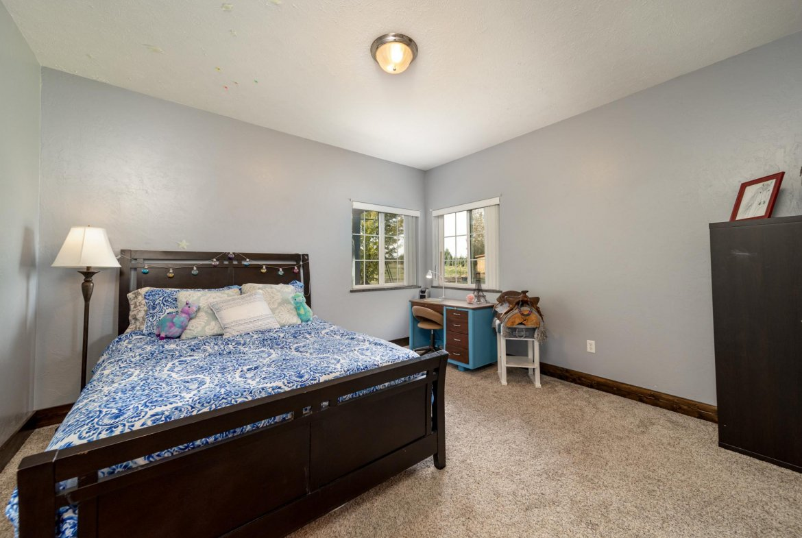 Large Bedroom with Carpet - 12703 6100 Rd Montrose, CO 81403 - Atha Team Country Real Estate