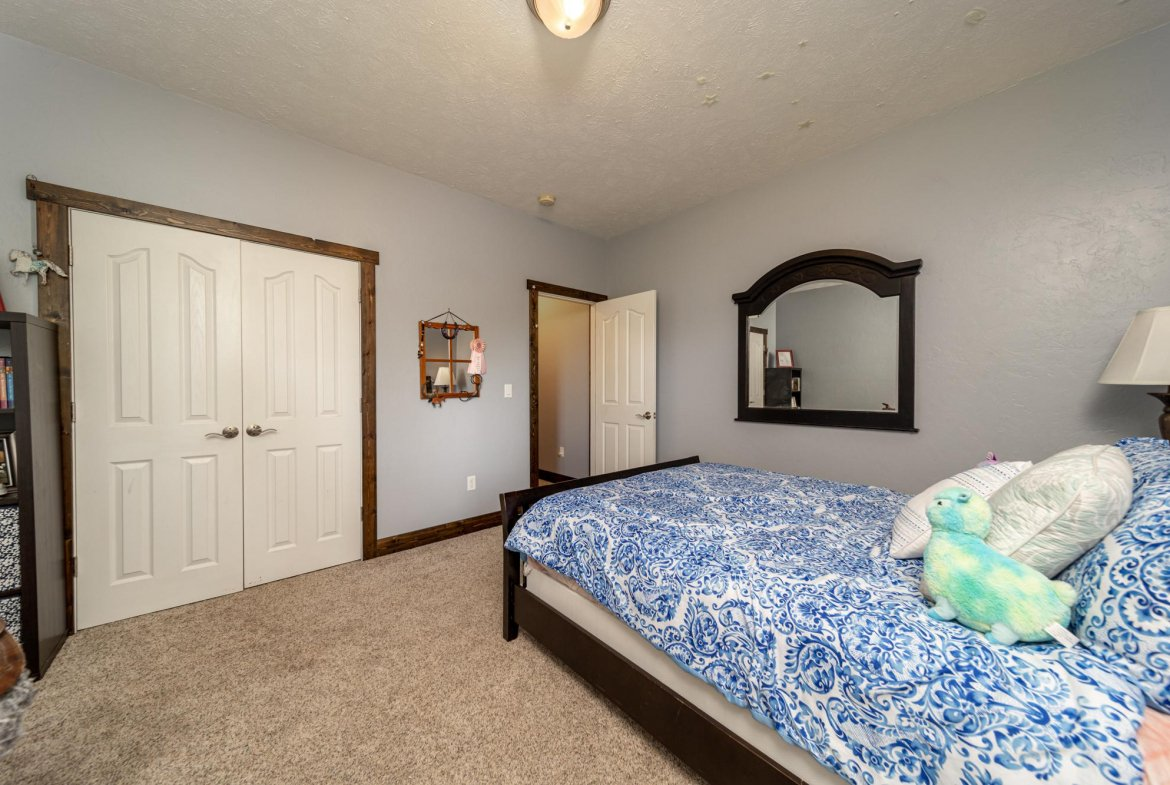 Large Bedroom with Closet - 12703 6100 Rd Montrose, CO 81403 - Atha Team Country Real Estate