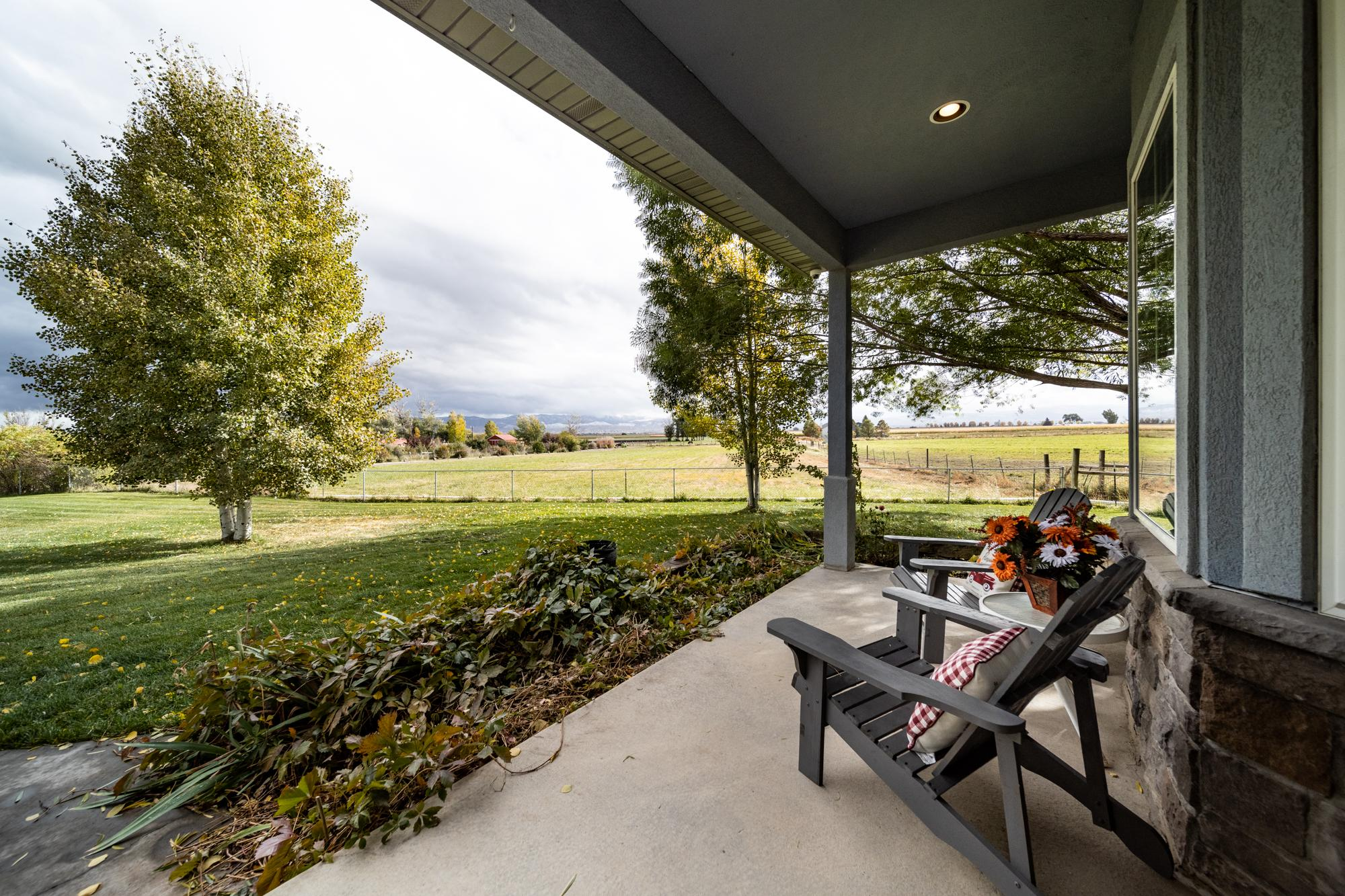 Covered Back Porch - 12703 6100 Rd Montrose, CO 81403 - Atha Team Country Real Estate