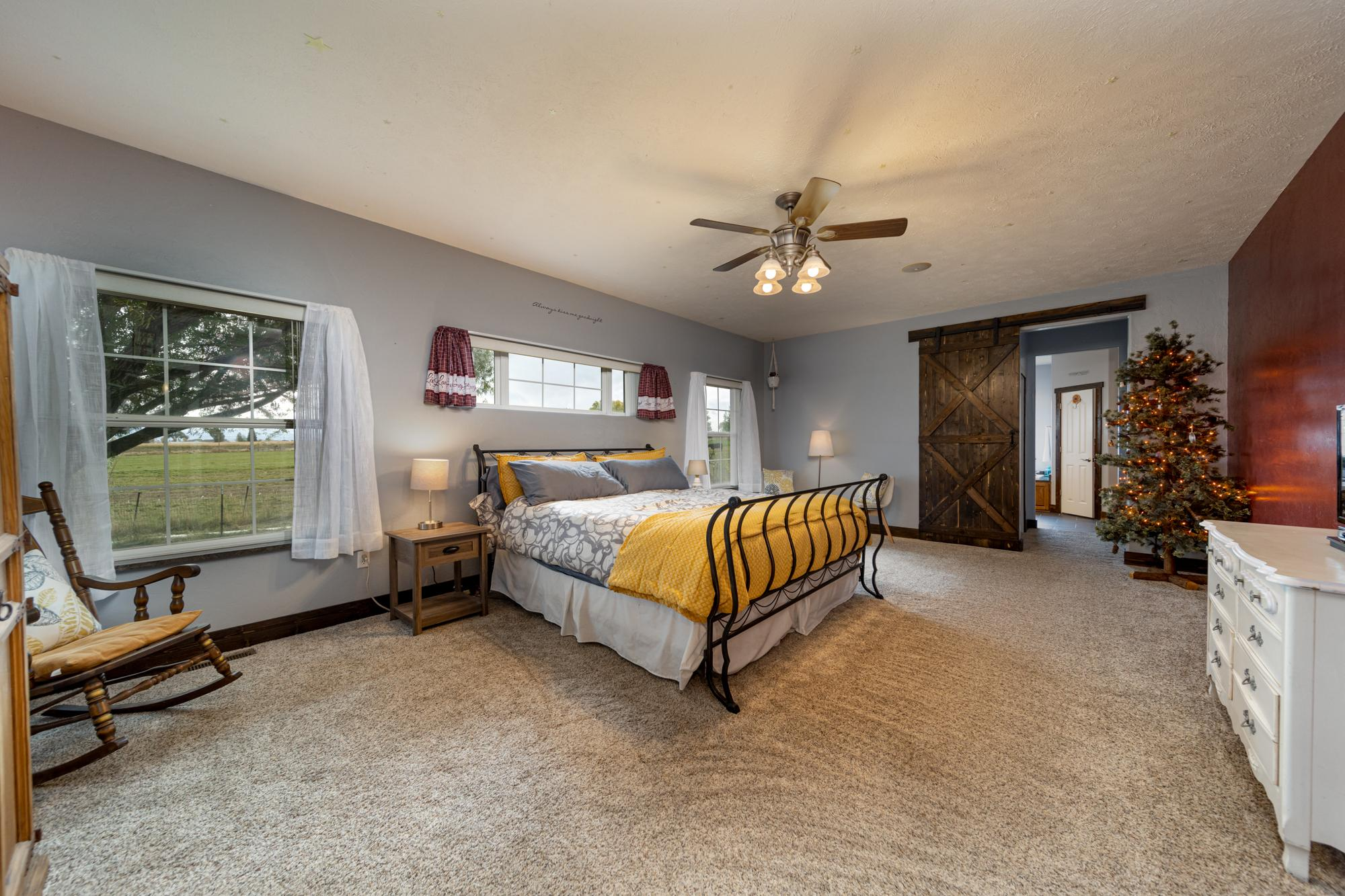 Main Bedroom with Ceiling Fan - 12703 6100 Rd Montrose, CO 81403 - Atha Team Country Real Estate