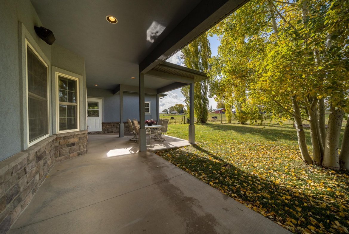 Large Covered Back Patio - 12703 6100 Rd Montrose, CO 81403 - Atha Team Country Real Estate