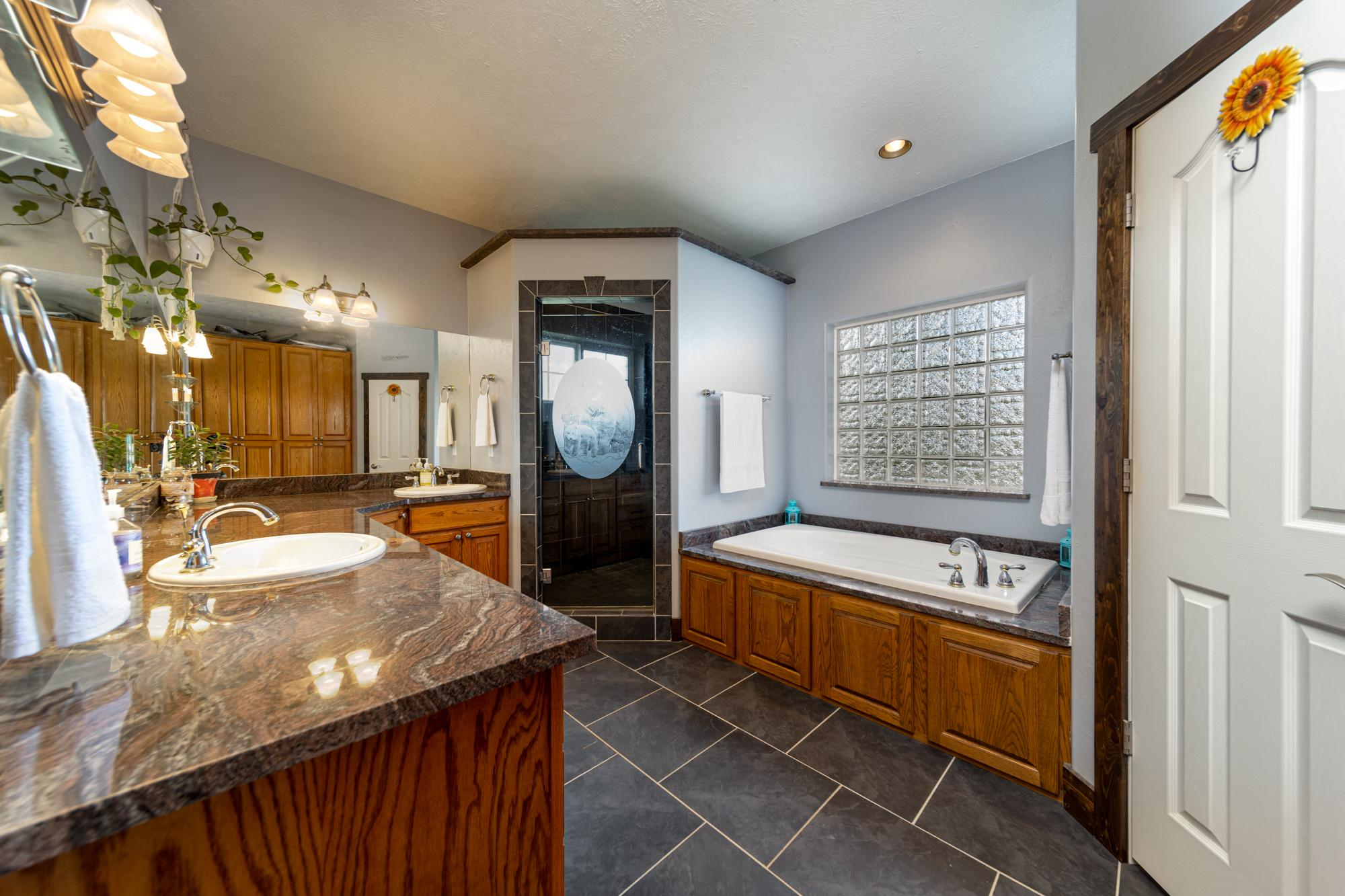 Main Bathroom with Slate Tile - 12703 6100 Rd Montrose, CO 81403 - Atha Team Country Real Estate