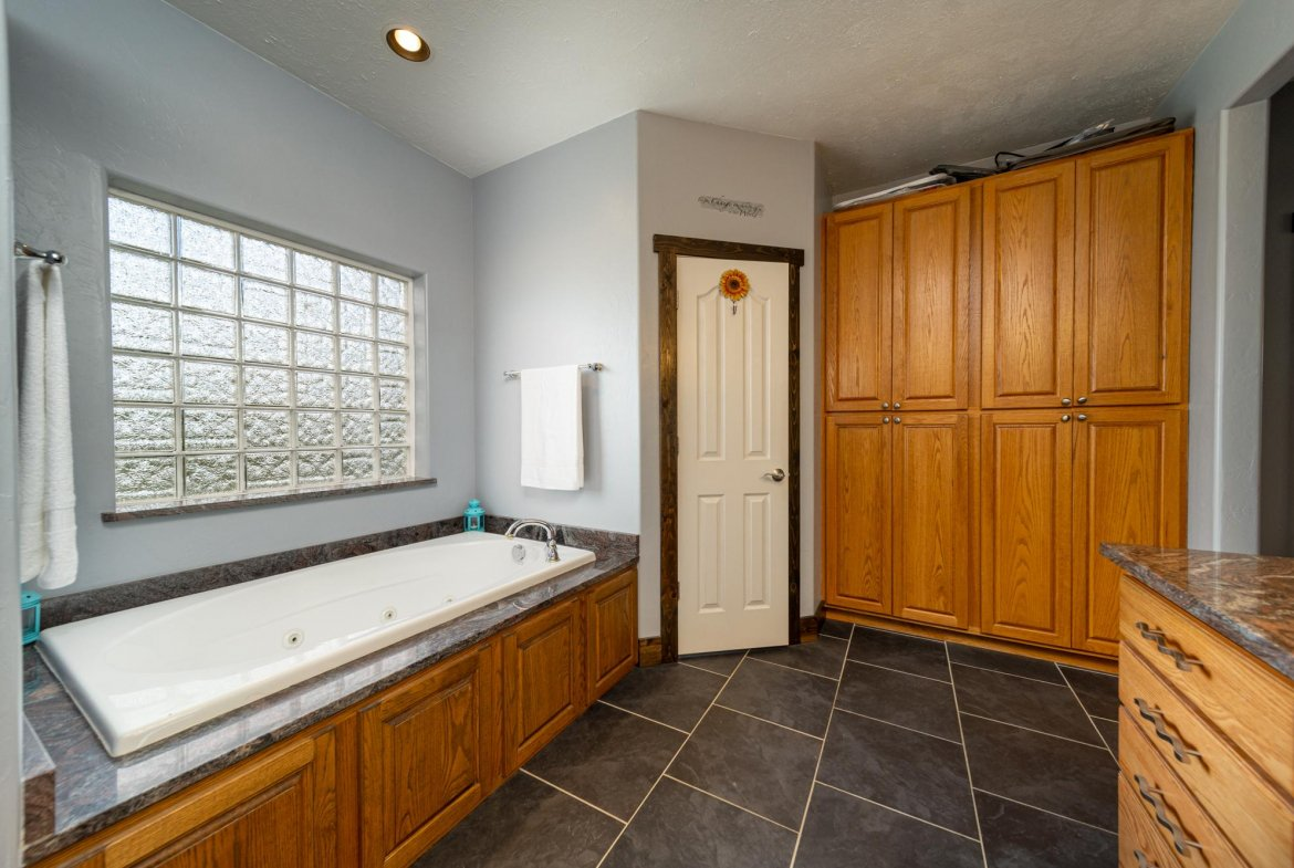 Main Bathroom with Closet - 12703 6100 Rd Montrose, CO 81403 - Atha Team Country Real Estate