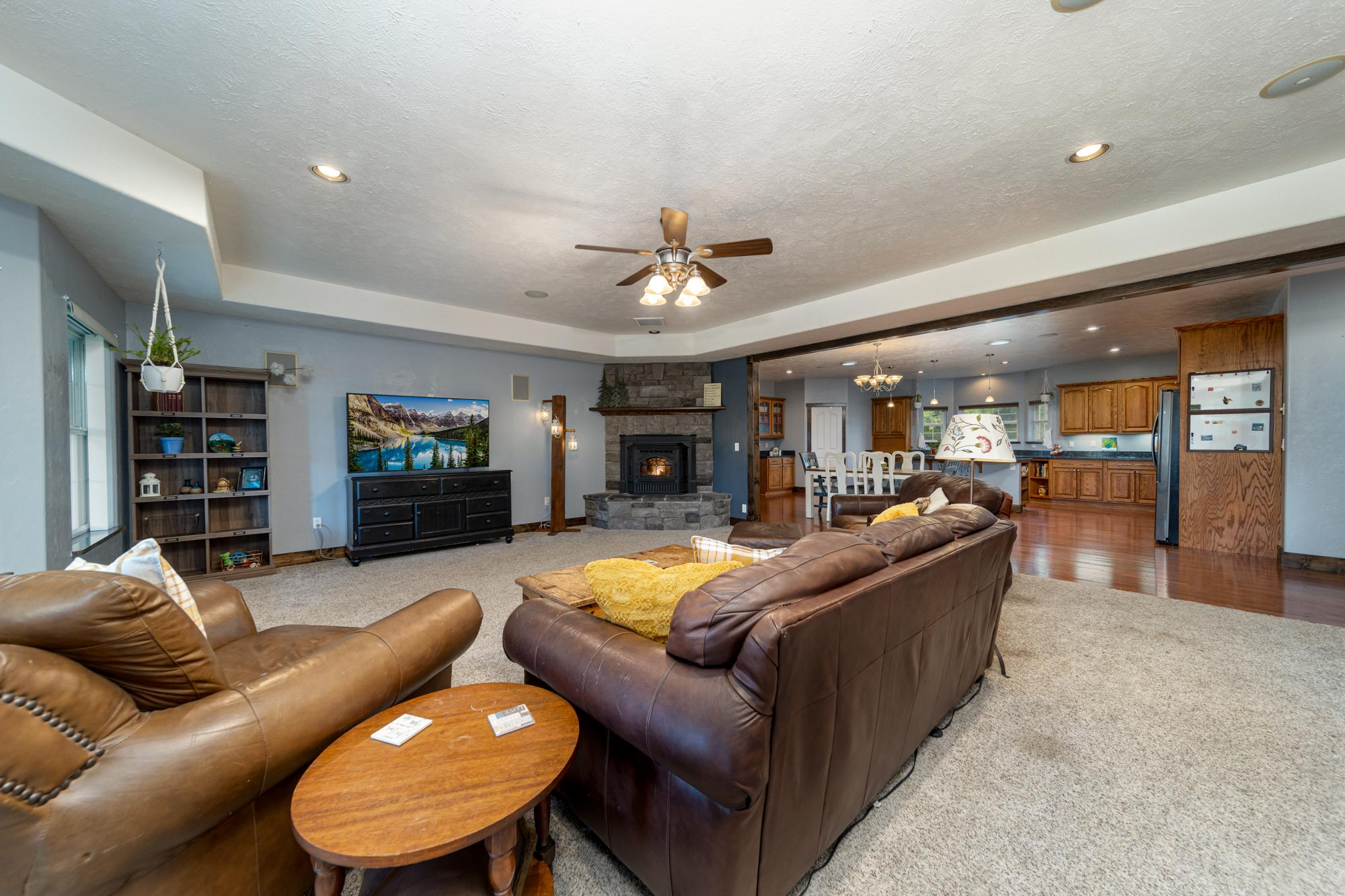 Living Room with Ceiling Fan - 12703 6100 Rd Montrose, CO 81403 - Atha Team Country Real Estate
